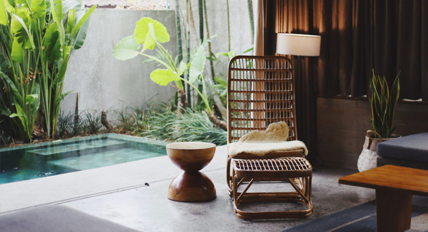 chair by the outdoor pool with side table